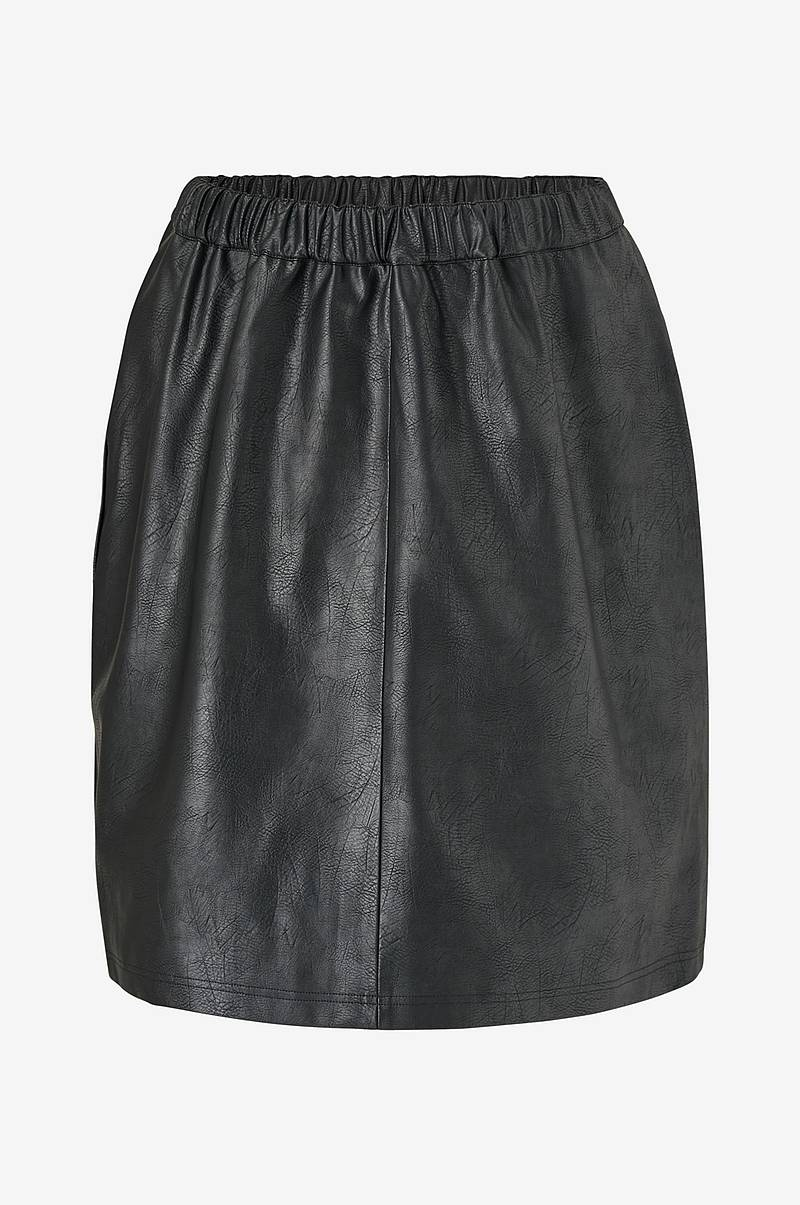 Nederdel jrSavannah HW Imitated Leather Skirt. A-formet model i flot, præget imiteret skind med vævet for. Påsyet linning med indsat elastik samt delesøm foran og bagpå. Længde ca. 60 cm i str. 44.