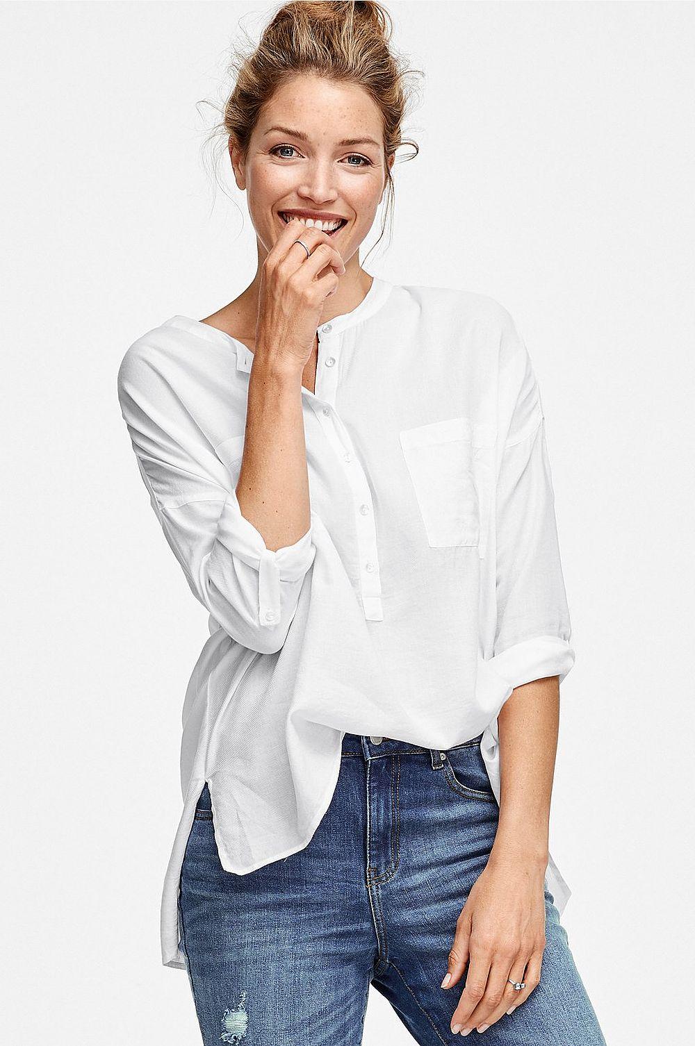 Kraglös skjorta. Modellens längd är 178 cm och bär storlek 36 35a7c5216c19c