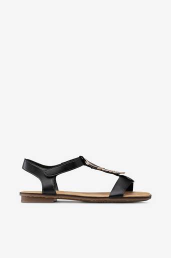 Sandaalit, joissa messinginvärinen koriste