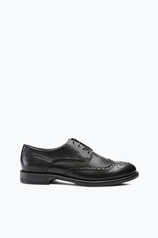 Amina-kengät, joissa broguekuvio