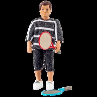 Nukkekodin nukke, jolla tennismaila