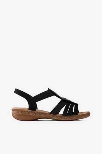 Sandaalit, joissa koristekiviä