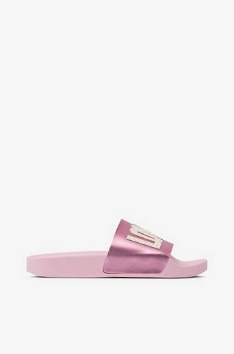 Love-sandaalit, joissa paljetteja