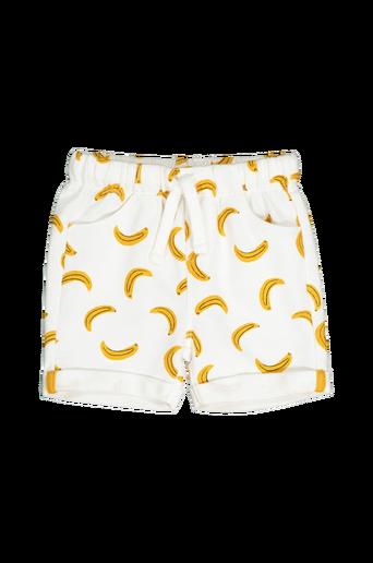 Banaanikuvioiset shortsit collegemateriaalia
