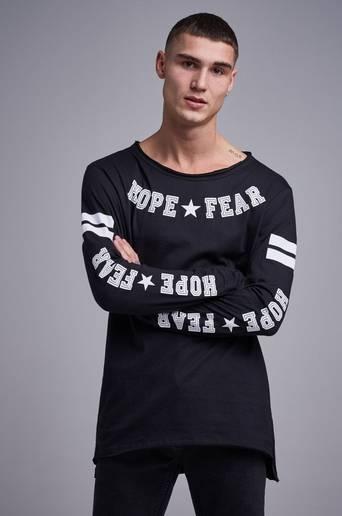 Bilde av Adrian Hammond Genser Hope And Fear Ls Svart
